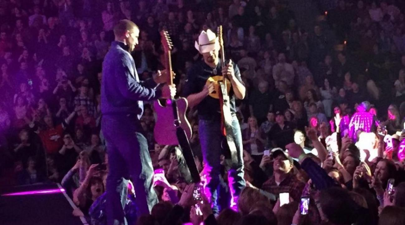 Packers' Jordy Nelson does some guitar tech work for Brad Paisley