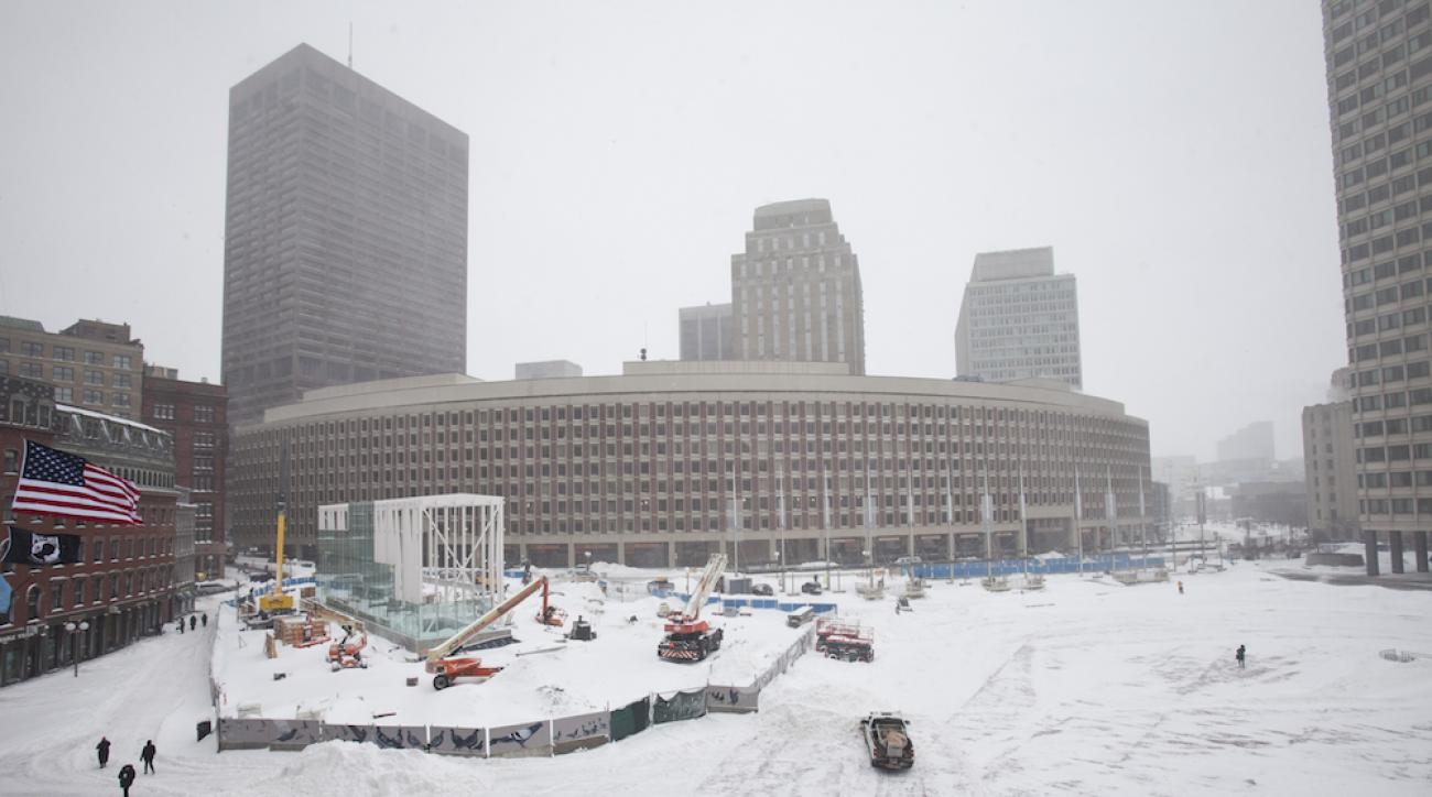 Crews removed snow from Boston's City Hall Plaza on Monday, the day before a planned Super Bowl victory parade for the Patriots.