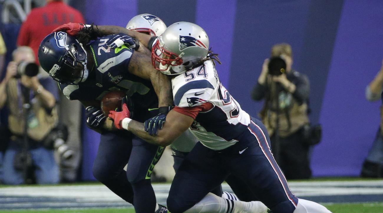 New England Patriots linebacker Dont'a Hightower (54) stops Seattle Seahawks running back Marshawn Lynch during the first half of Super Bowl XLIX.