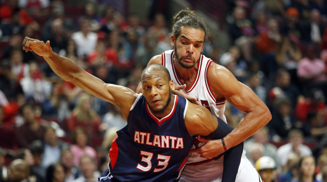 Adreian Payne (33) blocks out Chicago Bulls center Joakim Noah during a preseason game on Oct. 16, 2014.