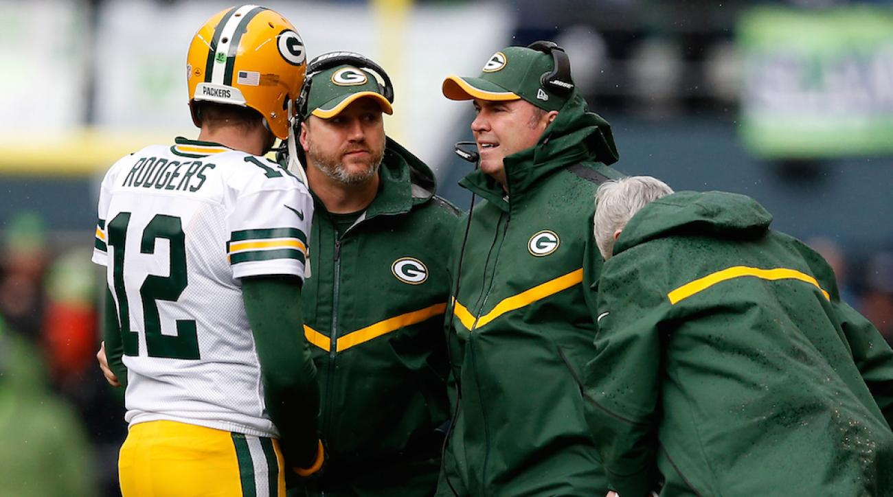 Green Bay Packers head coach Mike McCarthy (right, with headset) finalized his 2015 coaching staff on Thursday.