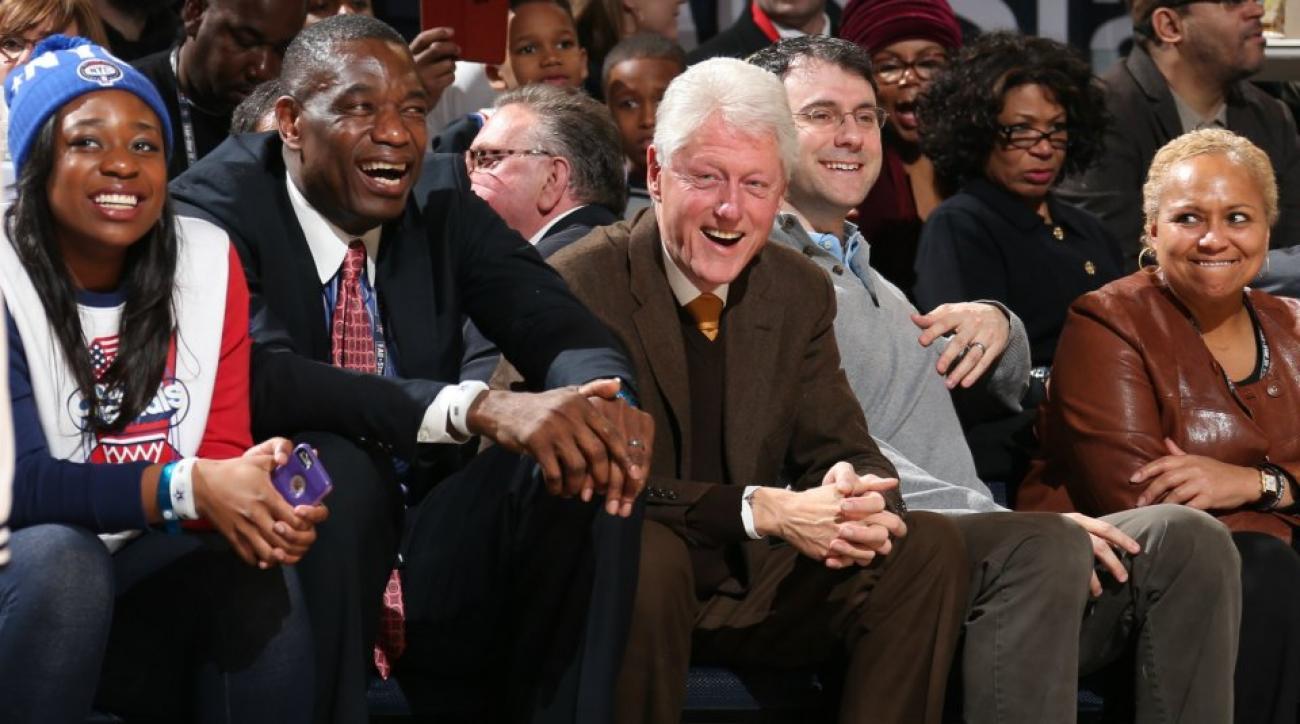 Bill Clinton and Dikembe Mutombo are All-Star buddies