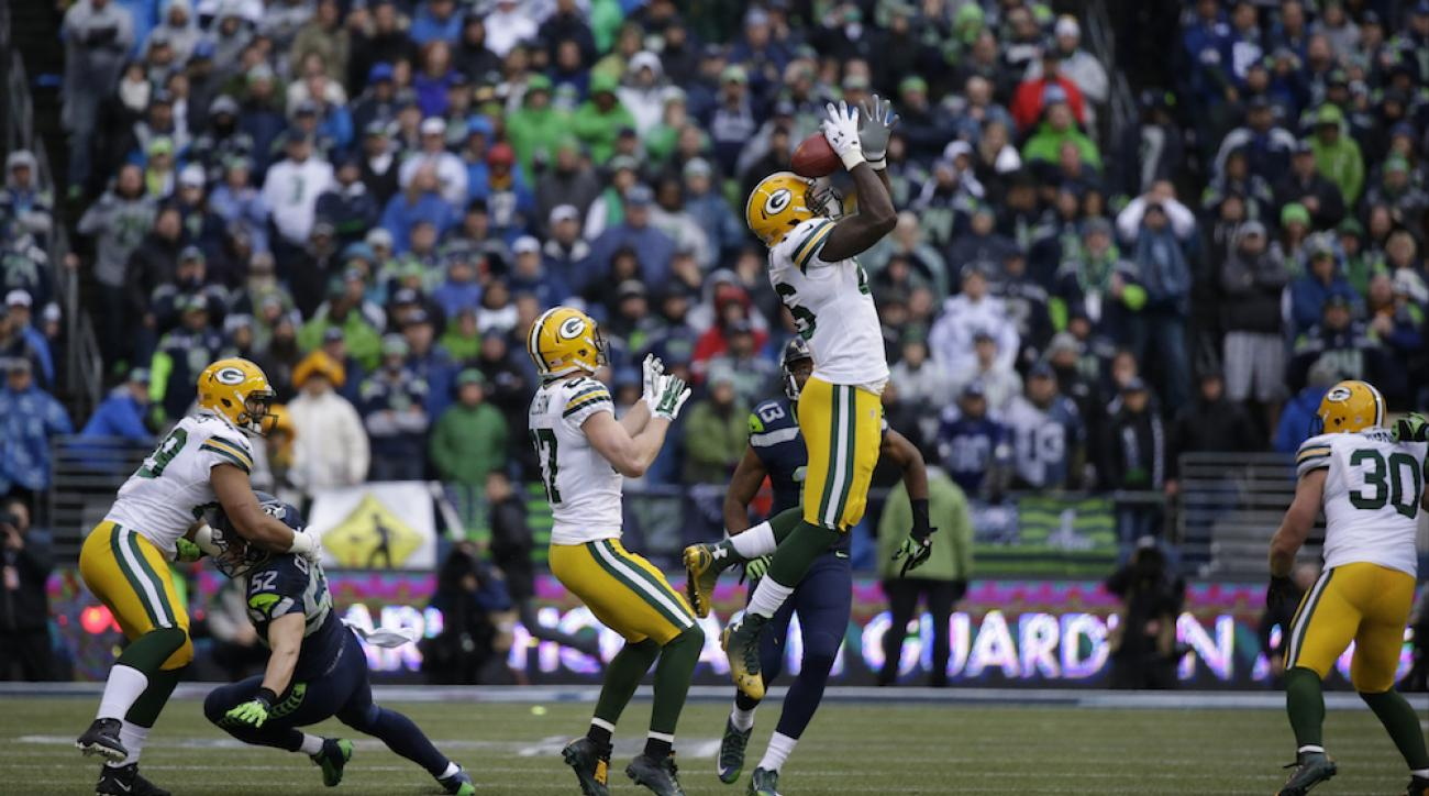 Green Bay Packers tight end Brandon Bostick (center, bobbling ball) was unable to corral the football after a late onside kick against the Seattle Seahawks in the NFC Championship Game on Jan. 18.