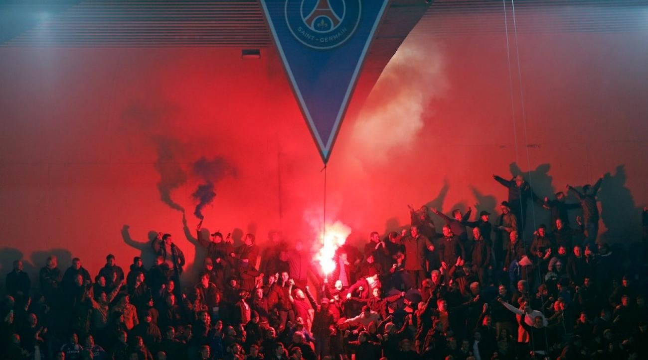 PSG fans light flares during Champions League match against Chelsea.