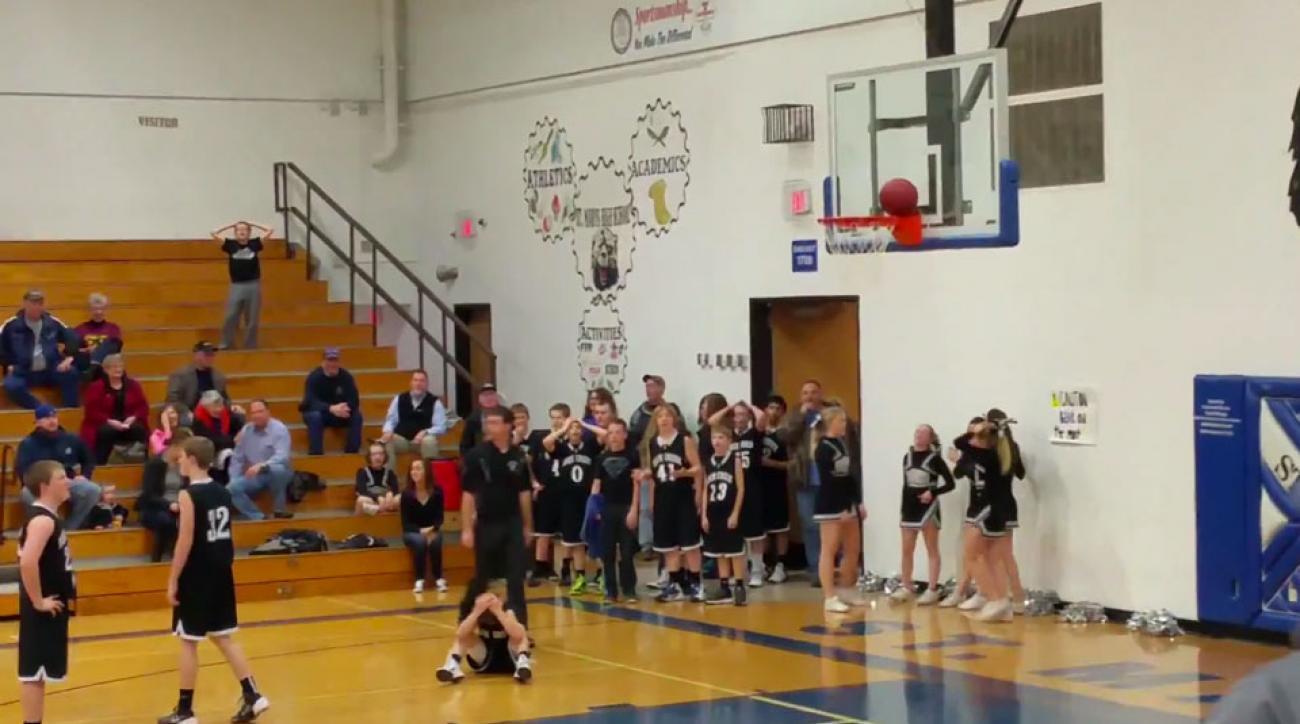 Basketball stuck on rim
