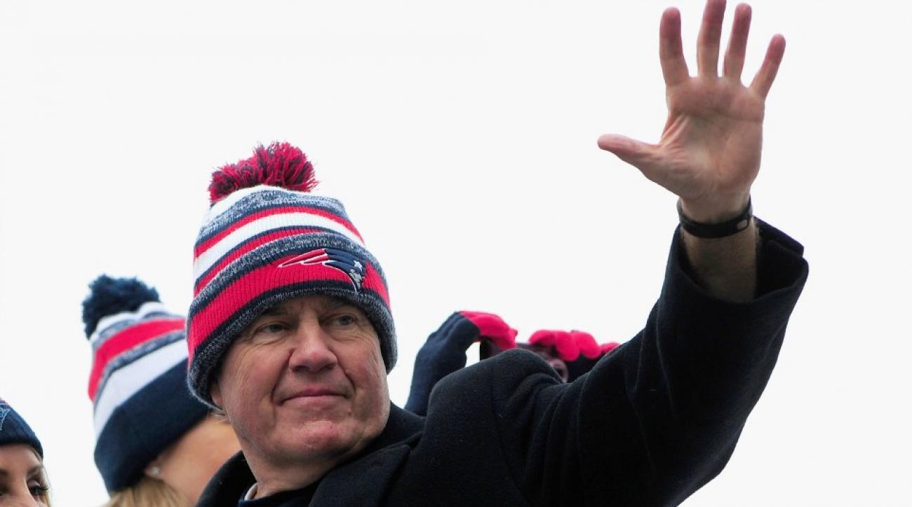 Bill Belichick licks his fingers at NFL combine