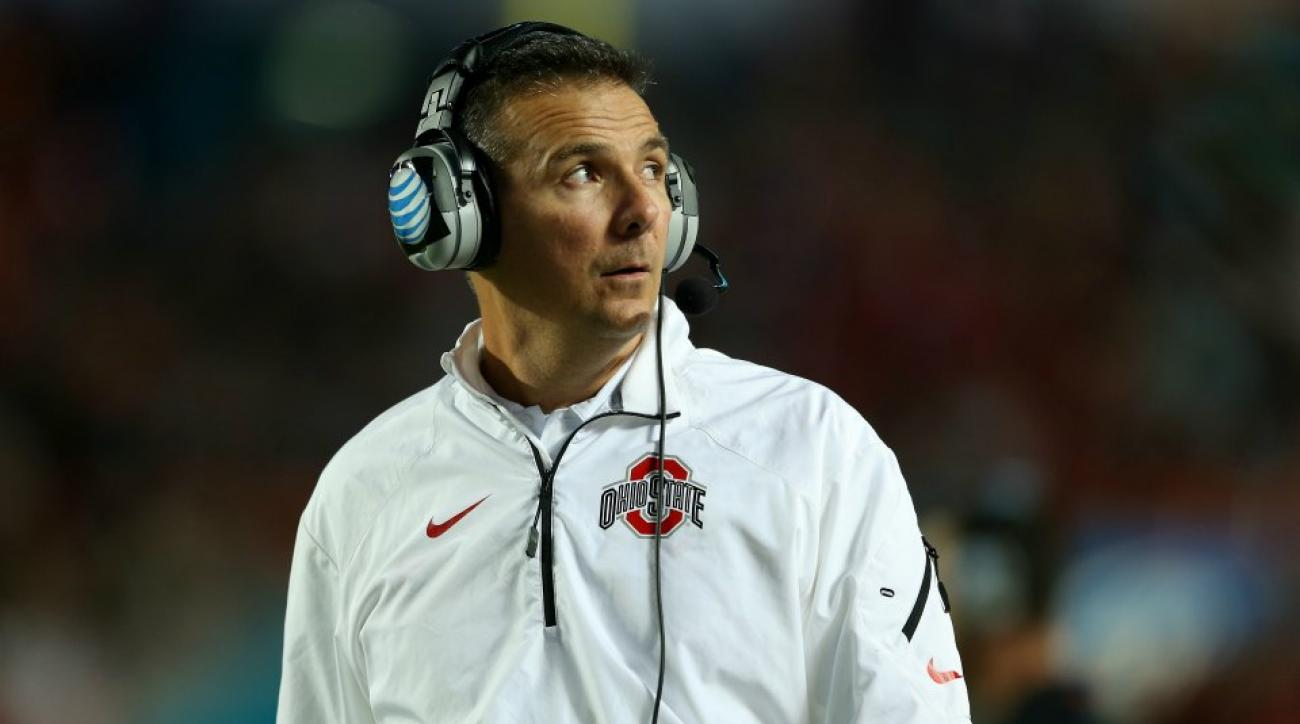 Ohio State's Urban Meyer returns after cruise held at sea