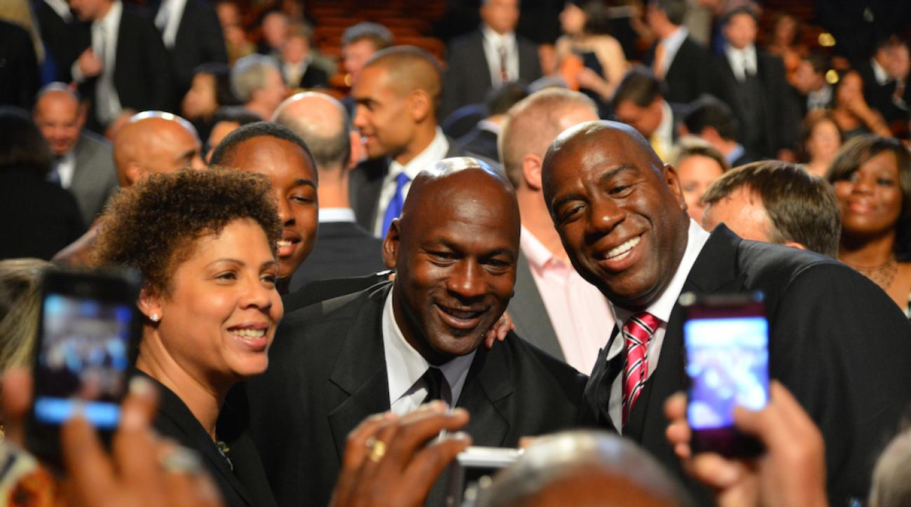 Cheryl Miller, Michael Jordan and Magic Johnson (l-r) at the 2012 Basketball Hall of Fame enshrinement ceremony.
