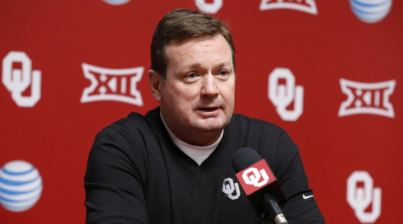 Stoops attends protest over racist video