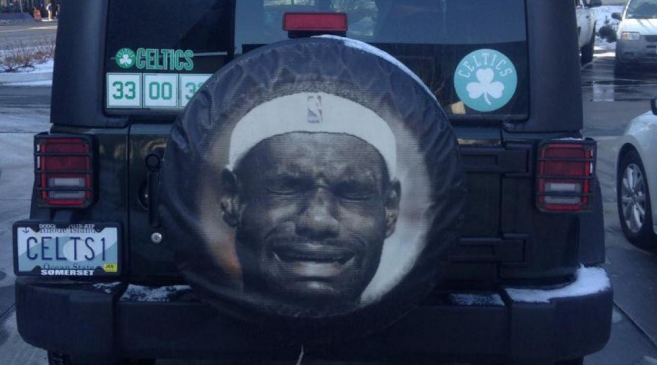 Celtics fan shows his dislike for LeBron James with tire cover