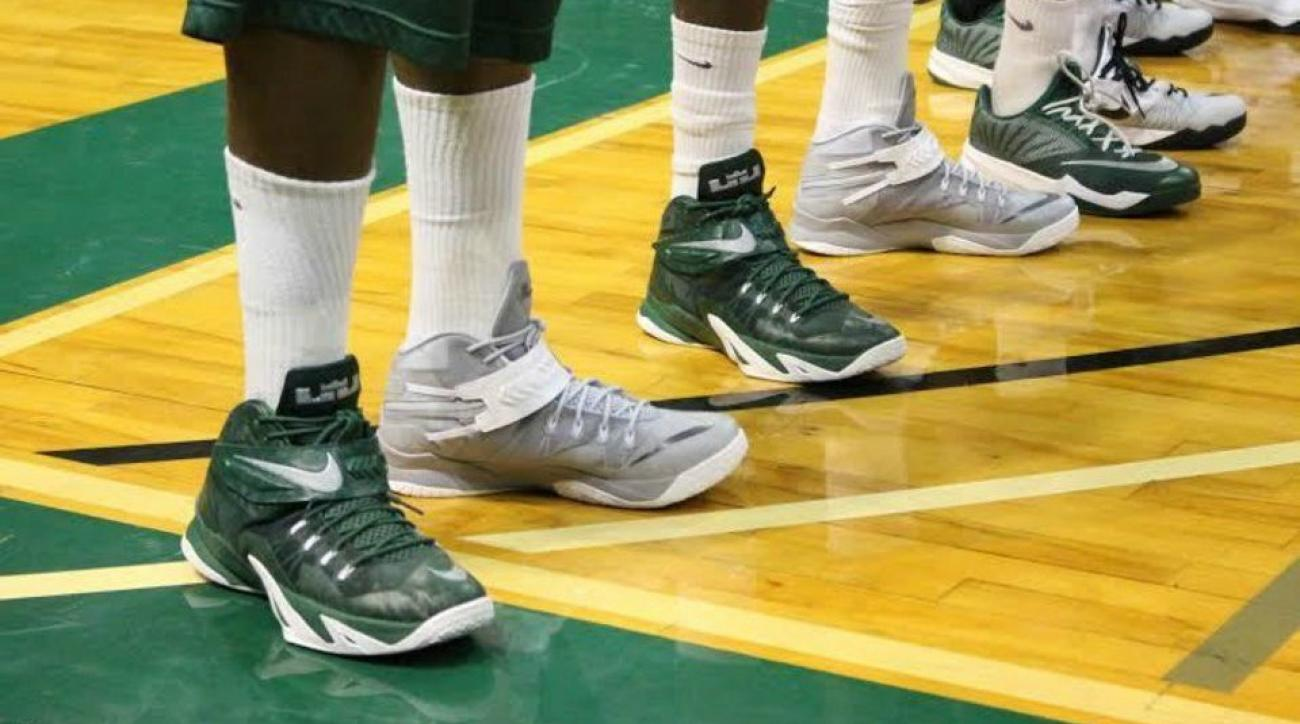 UAB's shoes are mismatched to promote childhood cancer awareness