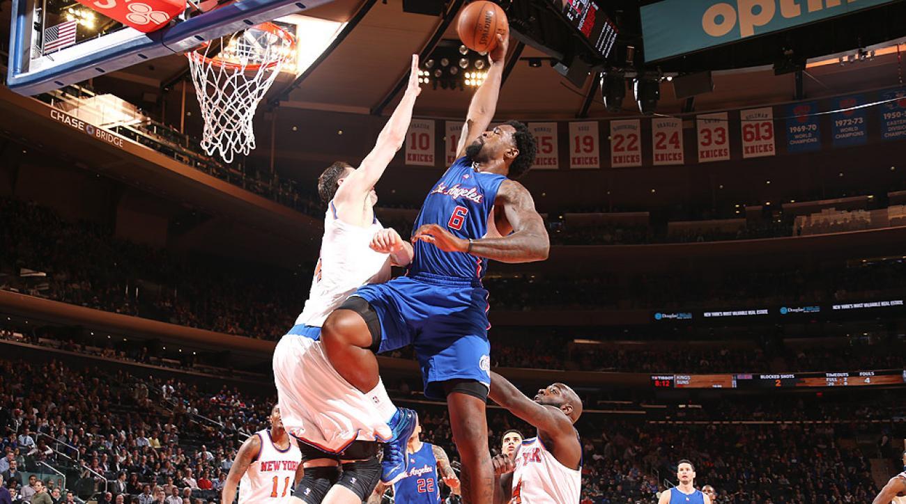 DeAndre Jordan threw down a huge dunk over Jason Smith on Wednesday.