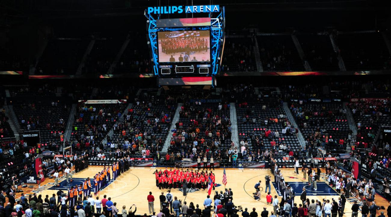 Four Atlanta bank robbers were sent to prison; they spent money on a Hawks suite.