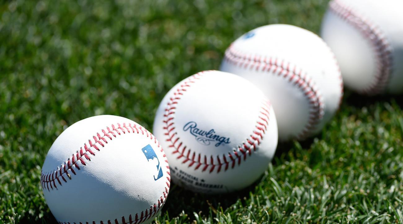 mlb baseballs grass