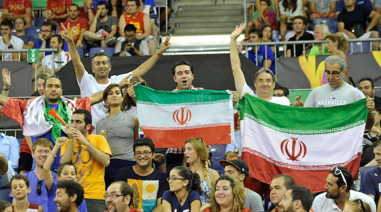 Fans cheer for Iran during a 2014 FIBA Basketball World Cup Group A match between Iran and Serbia at Palacio de Deportes in Granada, Spain on Sept. 1, 2014.