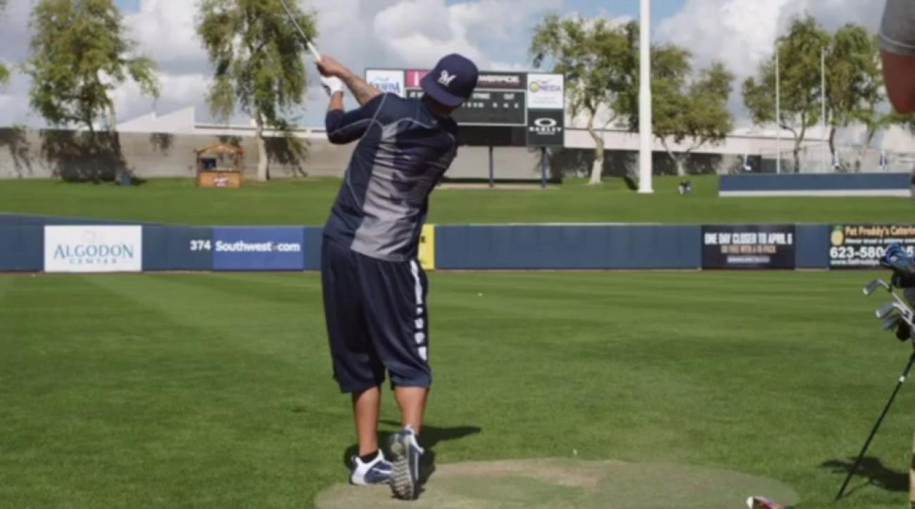 Milwaukee Brewers practice golf and baseball at the same time