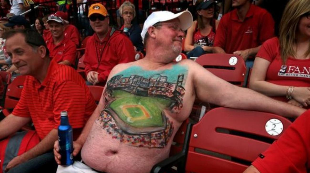 Cardinals fan paint Busch Stadium on his stomach