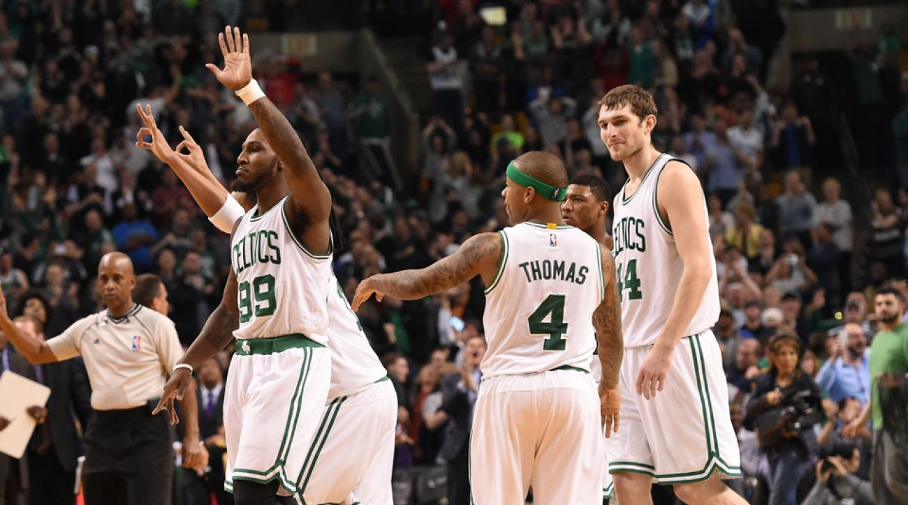 Jae Crowder (left) and the Celtics celebrate a victory over the Raptors.