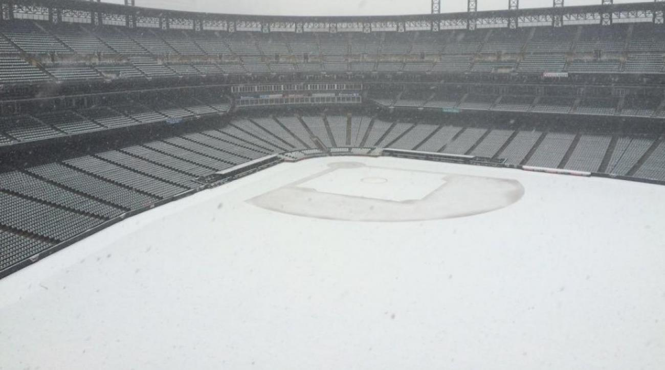 Coors field is covered in snow