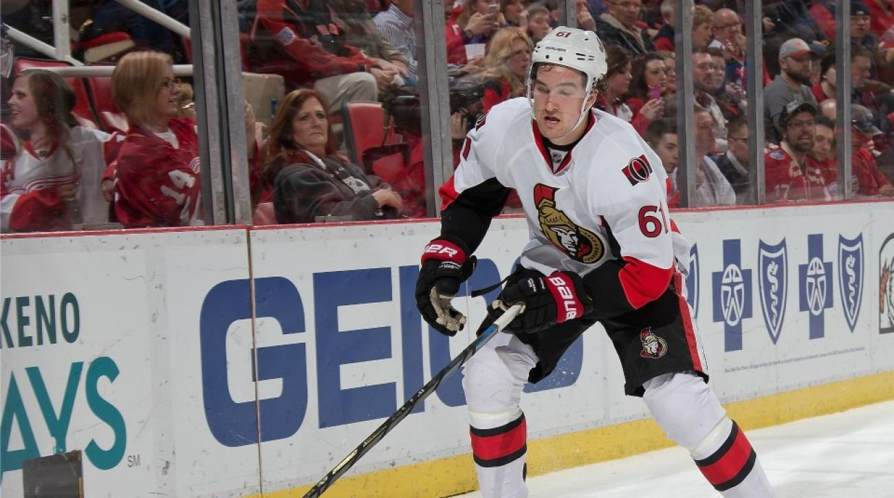 Senators Mark Stone has some trouble with a water bottle