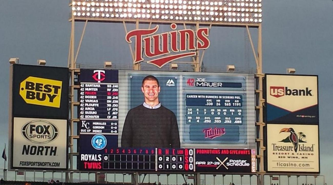 Twins players appear in casual clothes on scorboard