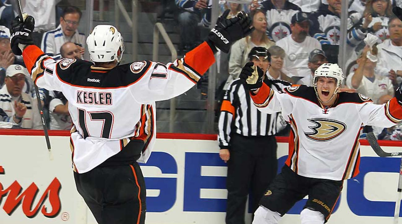 Jakob Silfverberg (above, right) celebrates with Ryan Kesler (17) after