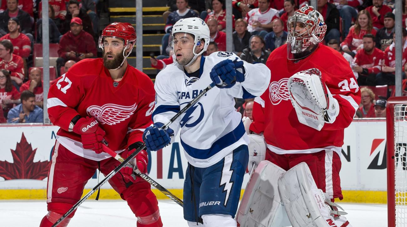 Tyler Johnson fights for position in front of Petr Mrazek