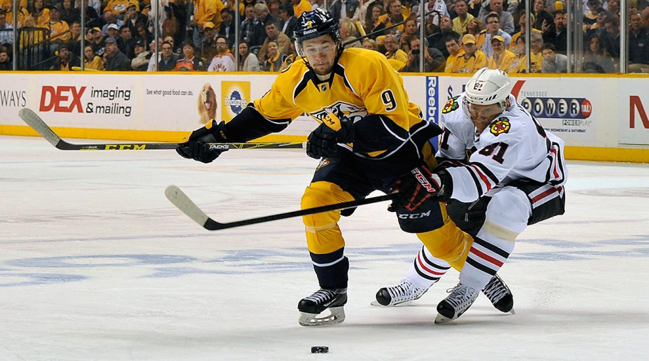 Filip Forsberg and Marian Hossa battle for the puck during Game 5.