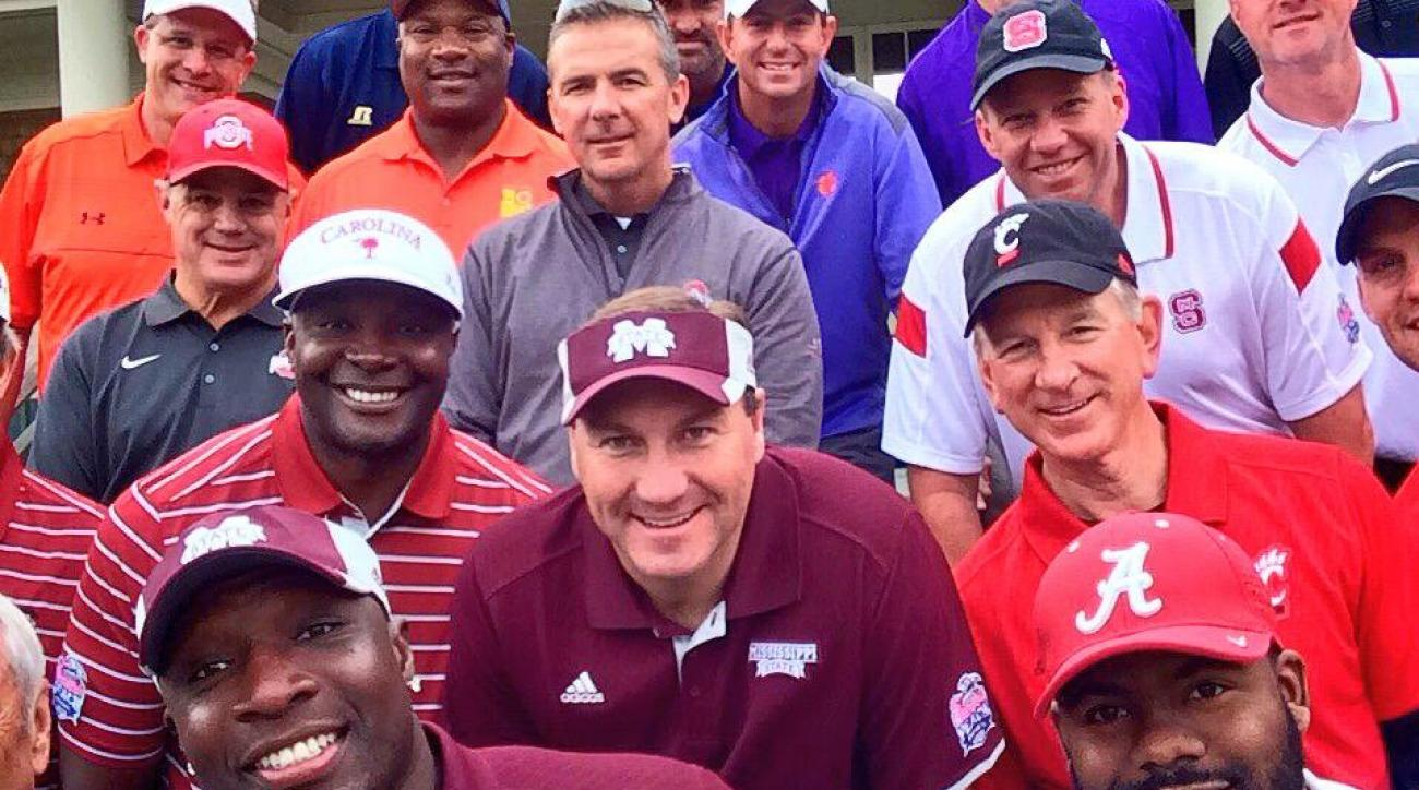 College coaches take group selfie at golf event