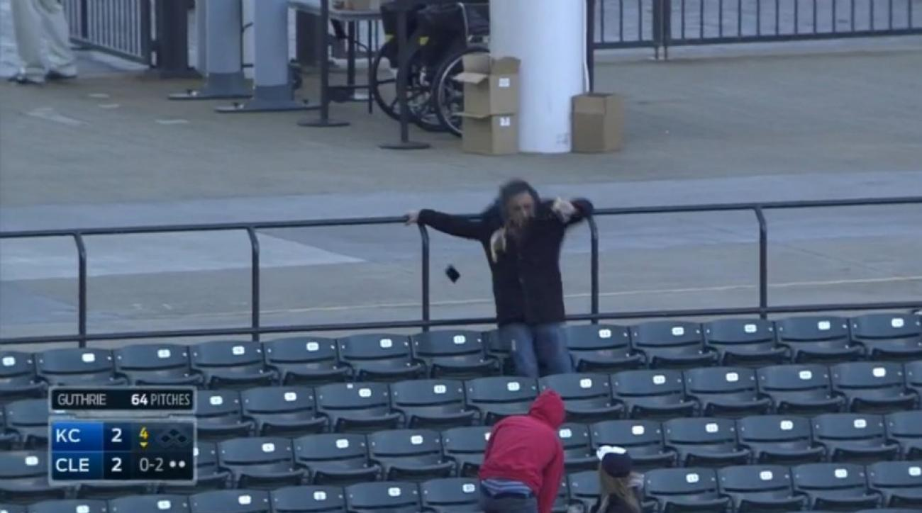 Cleveland fan sacrifices cell phone and beer for foul ball