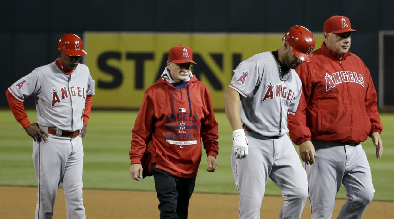 Pujols injuries hamstring, could miss series vs. Giants
