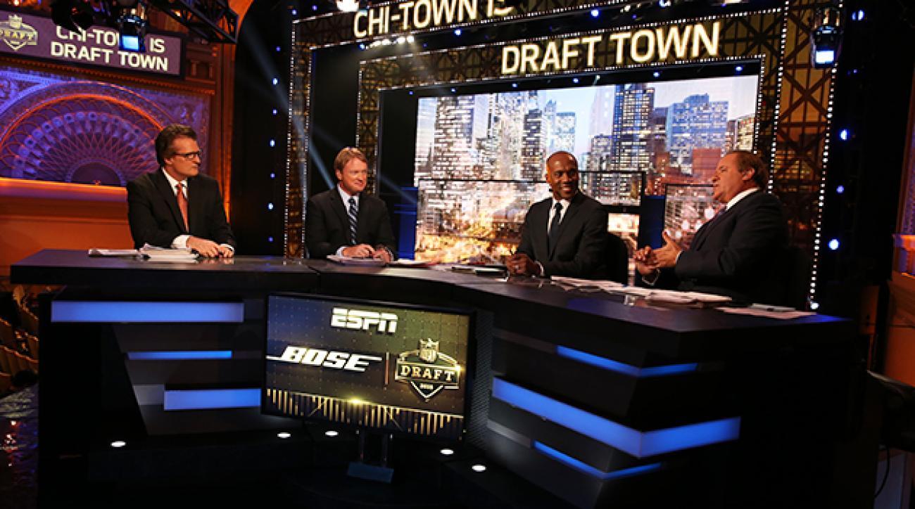 Mel Kiper Jr., Jon Gruden, Louis Riddick and Chris Berman on ESPN's NFL draft set in Chicago.