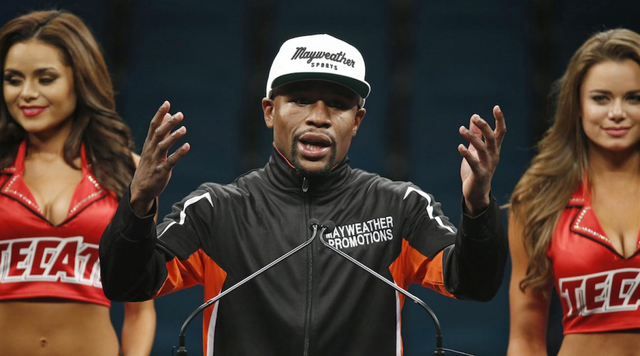 floyd mayweather relinquish titles defeats manny pacquiao