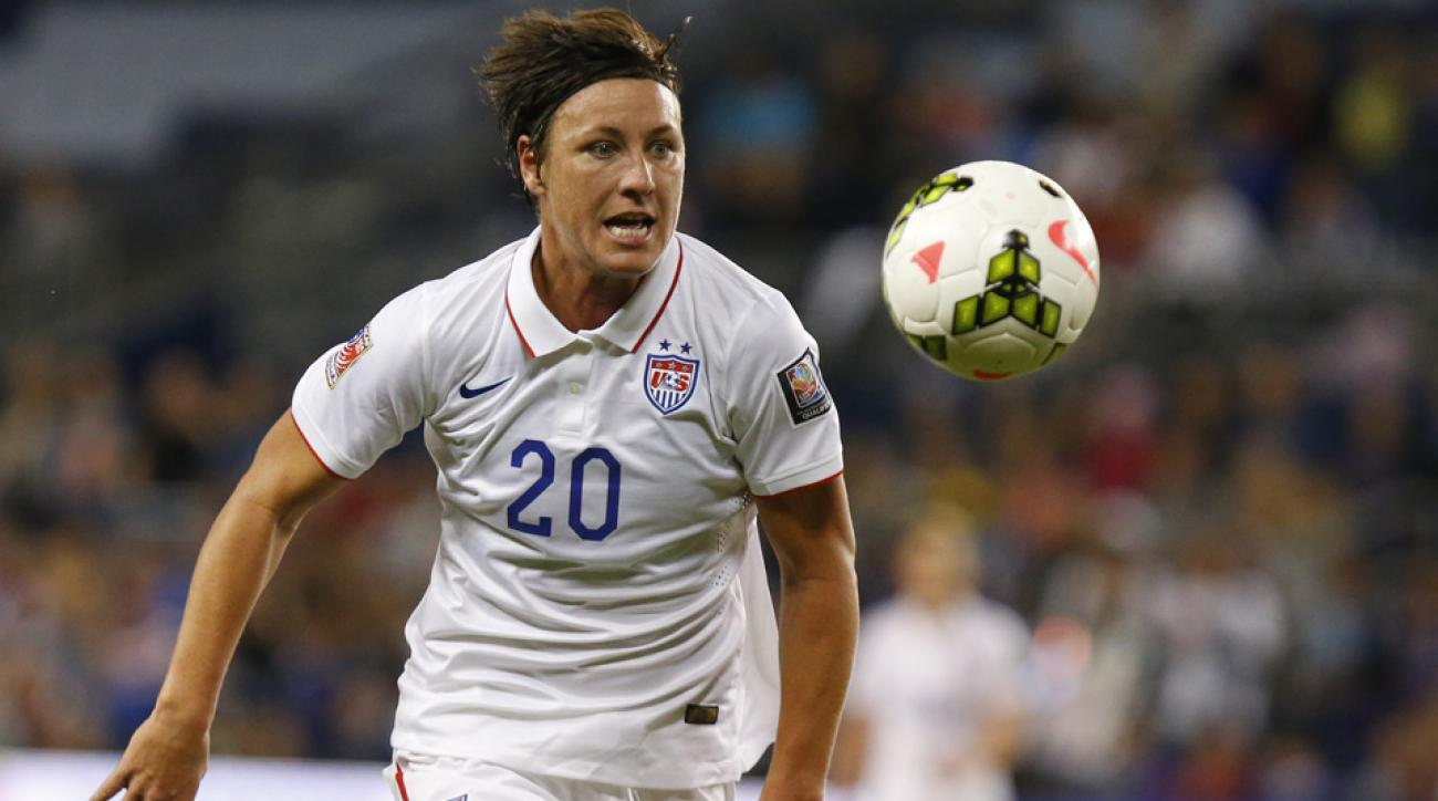 USWNT forward Abby Wambach says FIFA could have used free grass fields at the Women's World Cup.