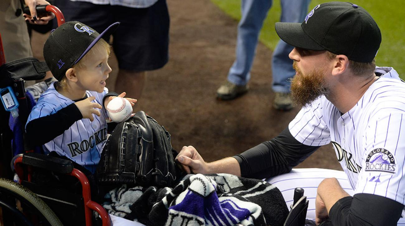 Rockies John Axford son throws first pitch