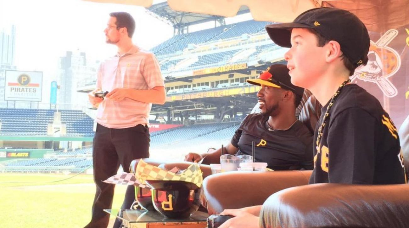 Pirates Andrew McCutchen plays scoreboard videogames with Make A Wish recipient