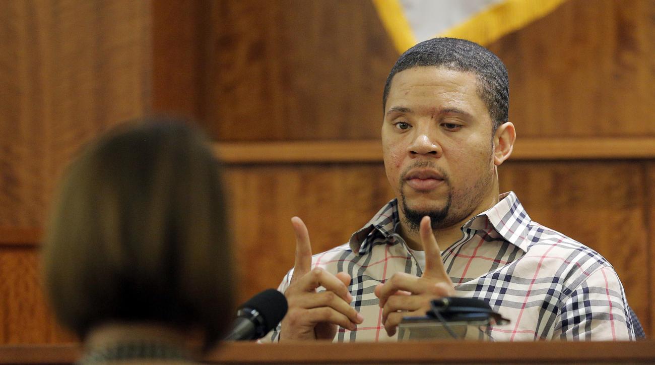 aaron hernandez charged witness intimidation