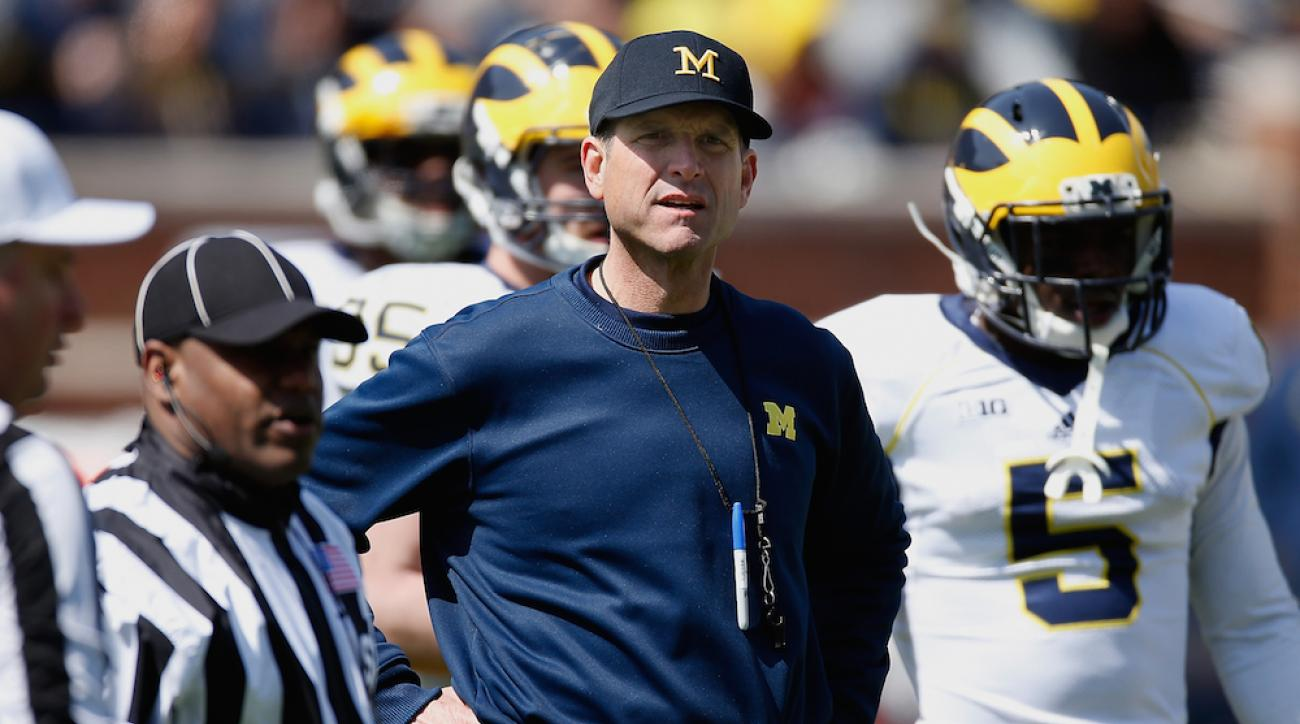 michigan football ncaa violations jim harbaugh