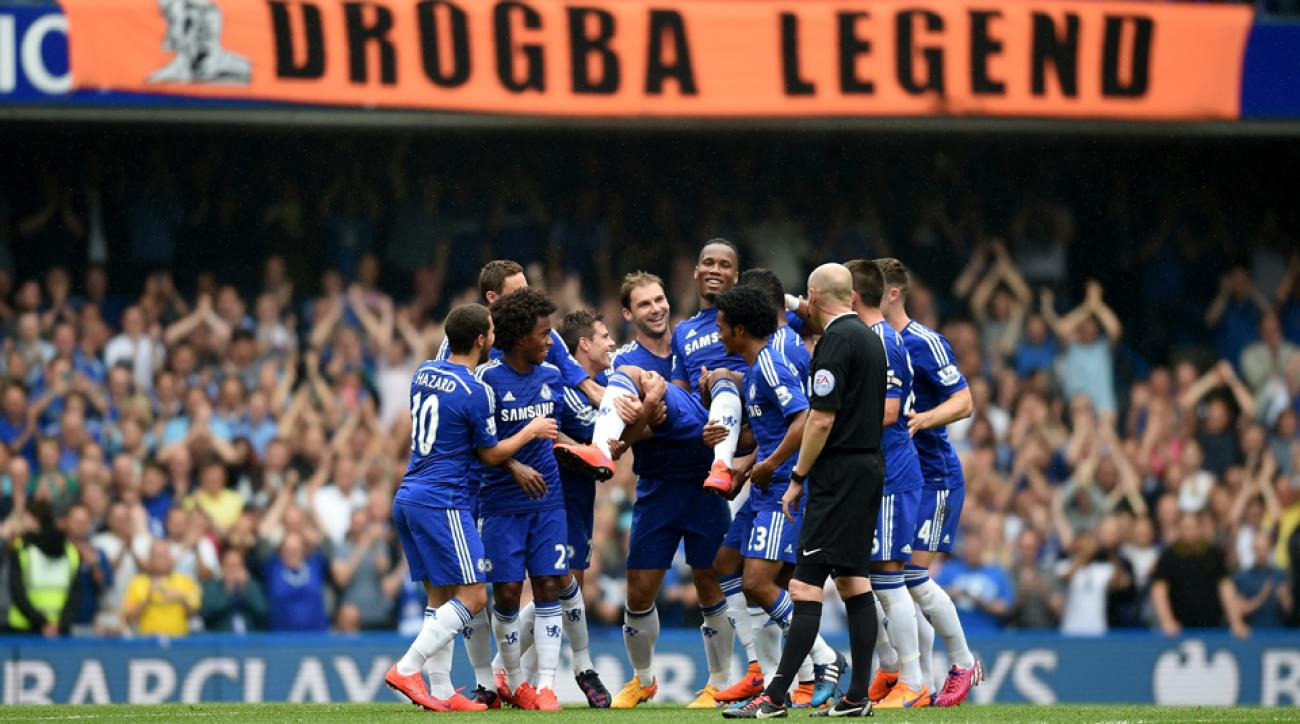 EPL Di r Drogba carried off the field by teammates final game