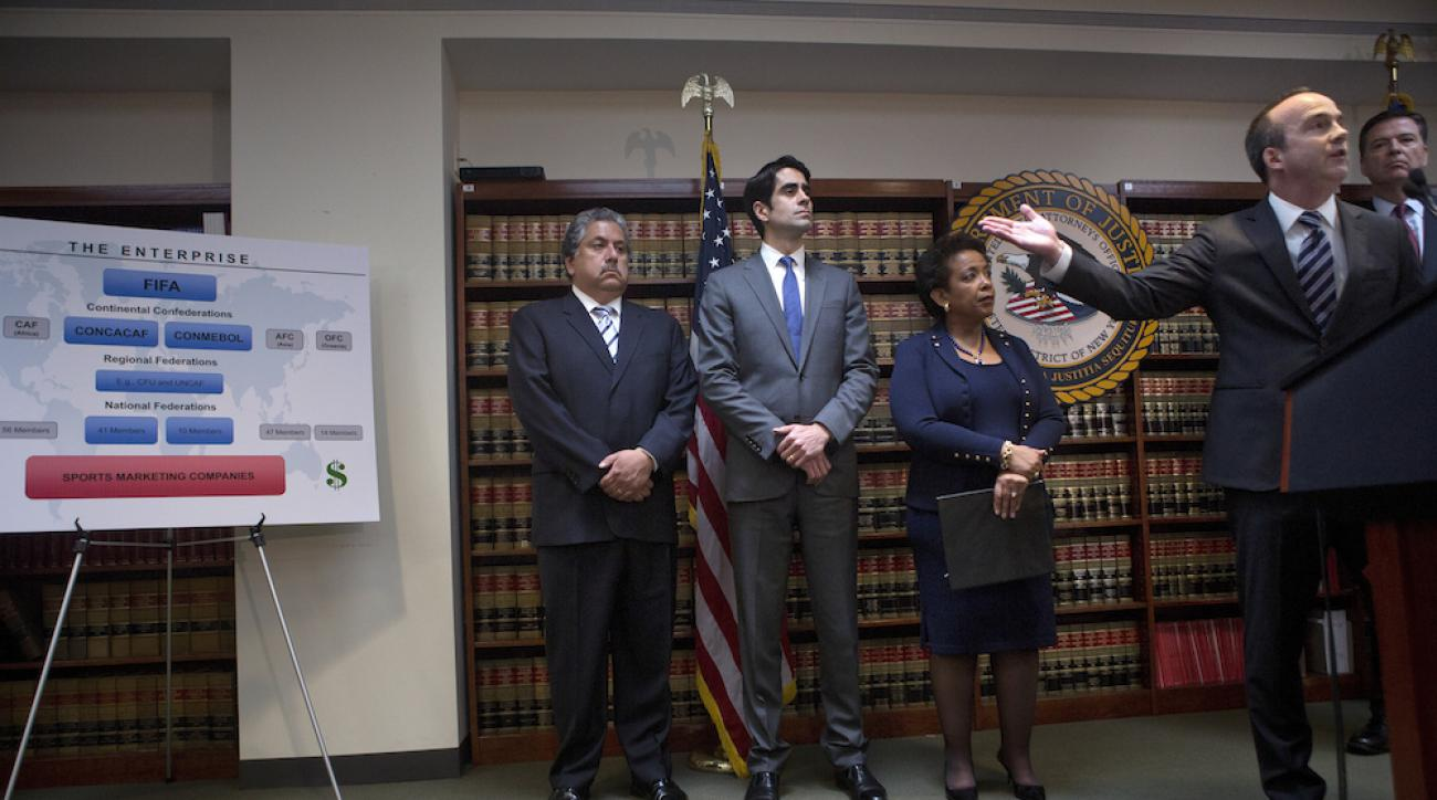 Kelly Currie, acting U.S. attorney for the Eastern District of New York, right, speaks during a news conference in Brooklyn, N.Y., on Wednesday.