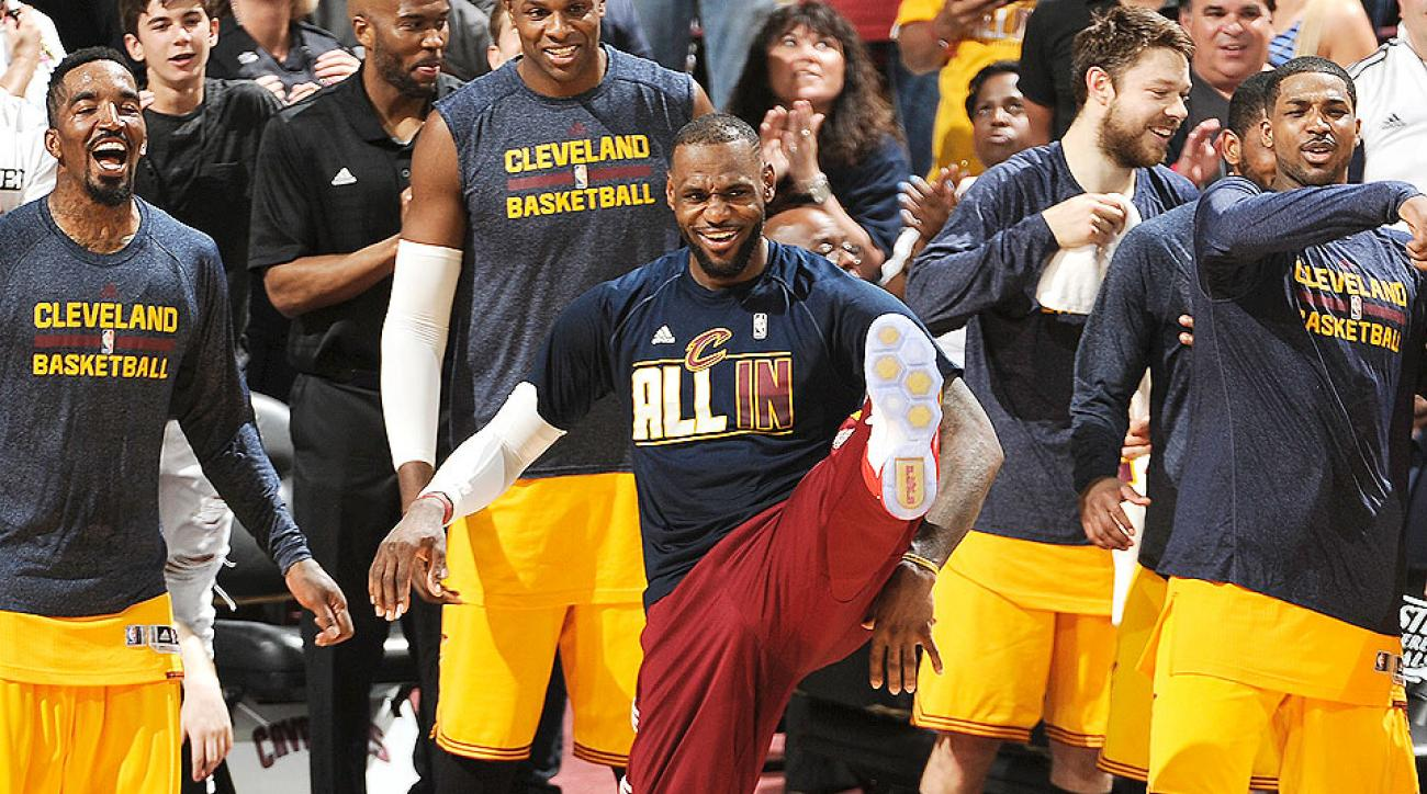 LeBron James, Cavaliers sweep Hawks to advance to NBA Finals.