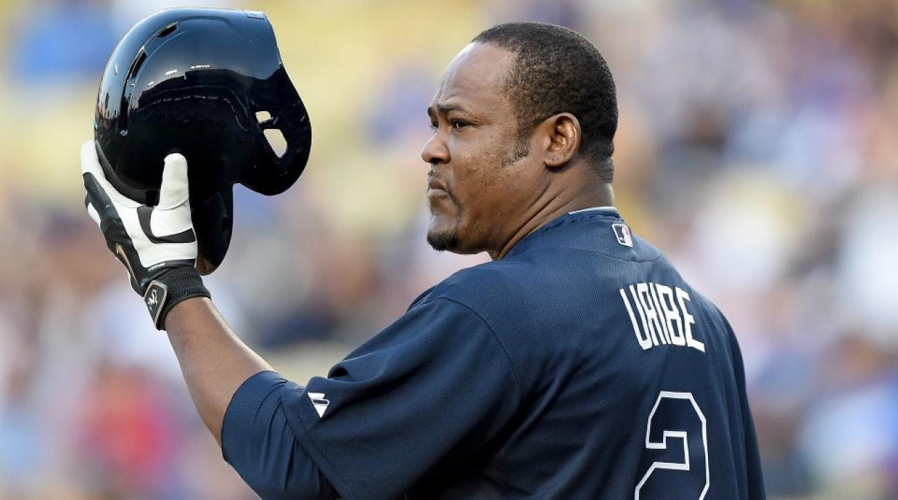 Juan Uribe's batting practice jersey lost an 'I' in his first day as a Brave