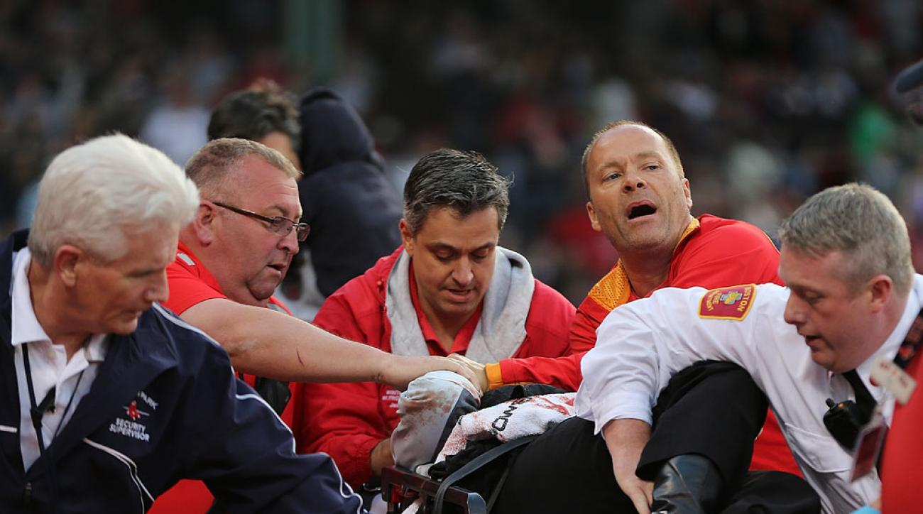 Medical staff respond Tonya Carpenter, the fan who was struck by a broken bat during Friday's Boston Red Sox game at Fenway Park.