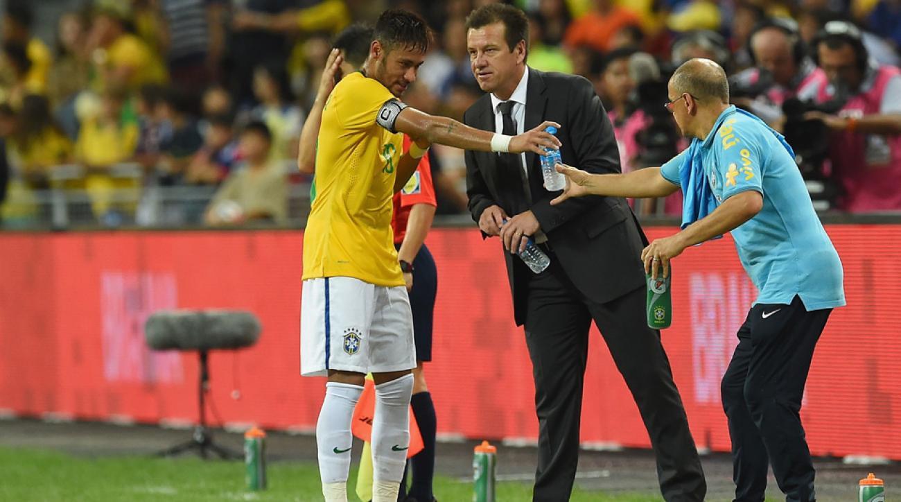 Brazil coach Dunga speaks to Neymar