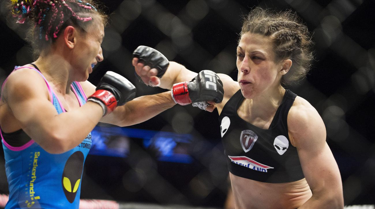 Joanna Jedrzejczyk throws a punch at Carla Esparza in their March 2015 bout, which Jedrzejczyk won.
