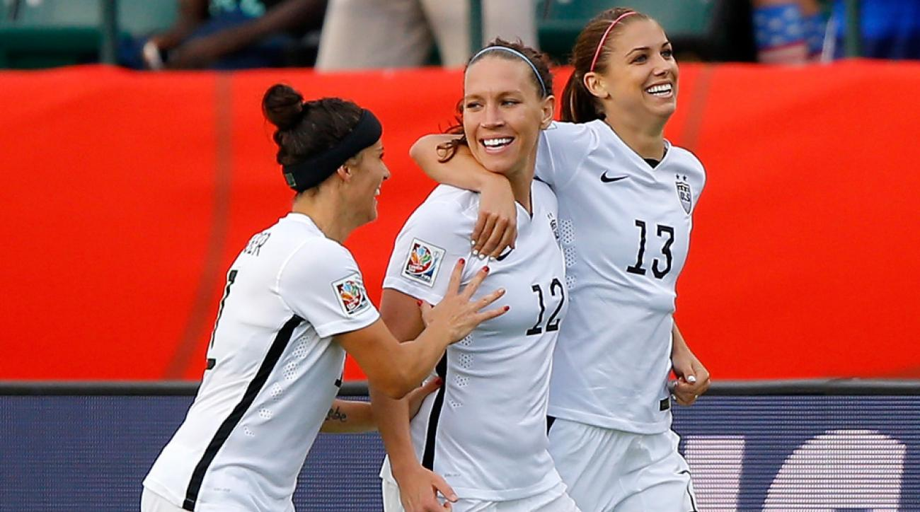 Ali Kreiger, Lauren Holiday, Alex Morgan celebrate Morgan's goal vs. Colombia for the USA