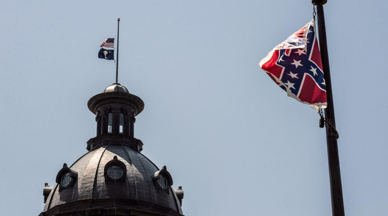 South Carolina athletic director Ray Tanner said the Confederate Flag should be taken down.
