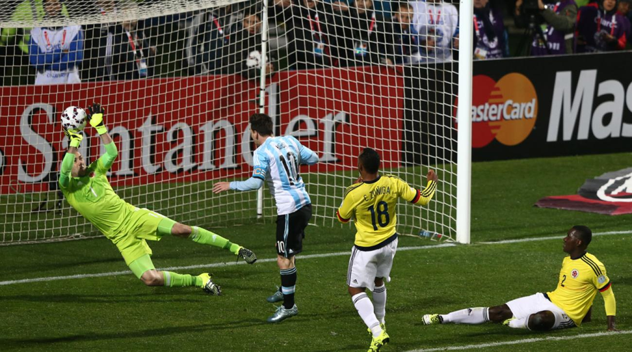 Colombia goalkeeper David Ospina robs Argentina's Lionel Messi at Copa America
