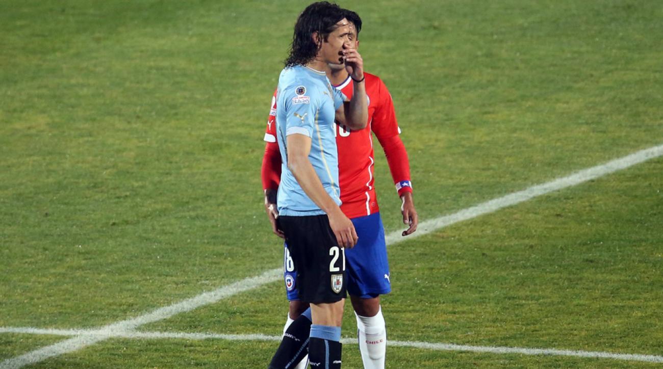 Chile's Gonzalo Jara pokes Uruguay's Edinson Cavani in the backside, resulting in a three-game Copa America ban