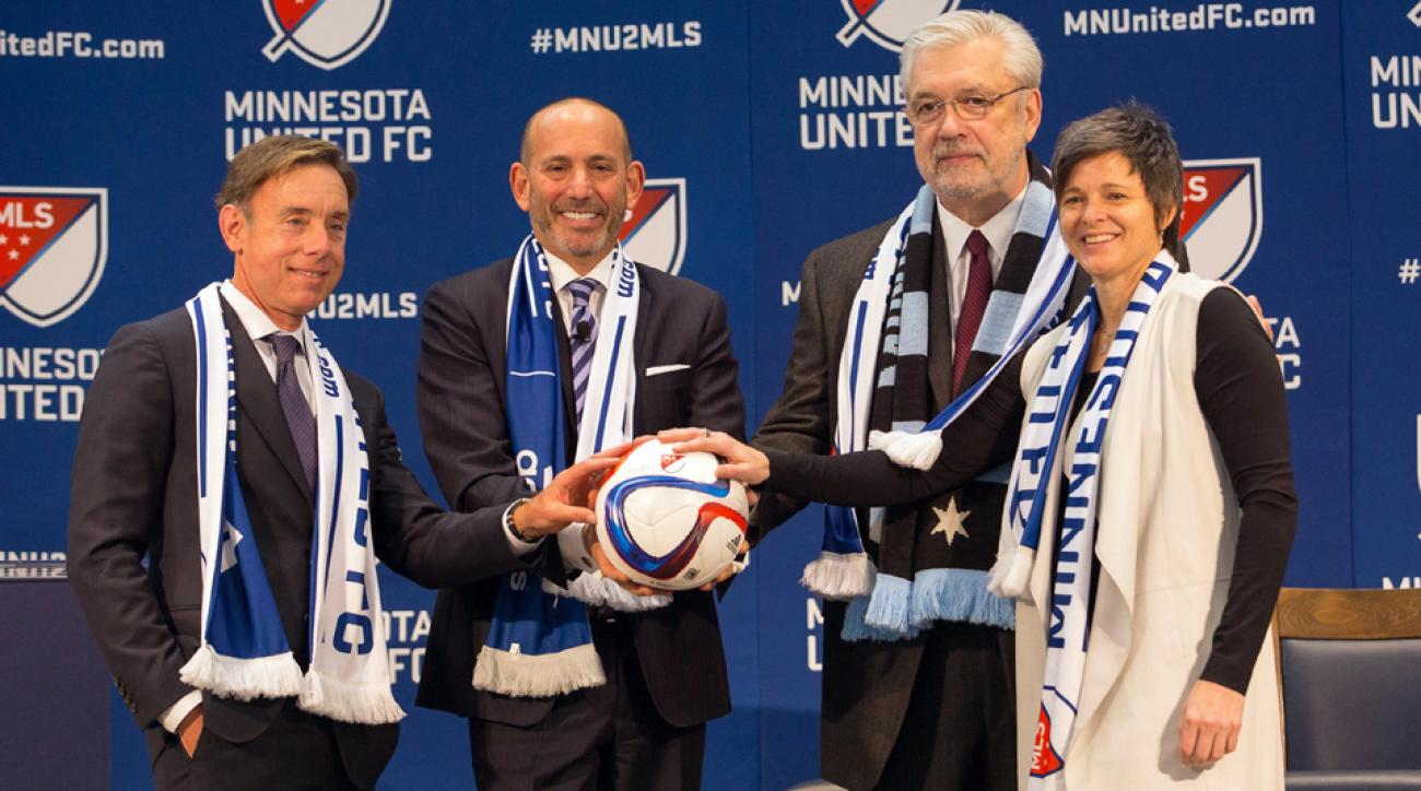 From left, Bob Pohlad, MLS commissioner Don Garber, Dr. Bill McGuire and Wendy Carlson Nelson pose during MLS's expansion announcement for Minnesota United FC